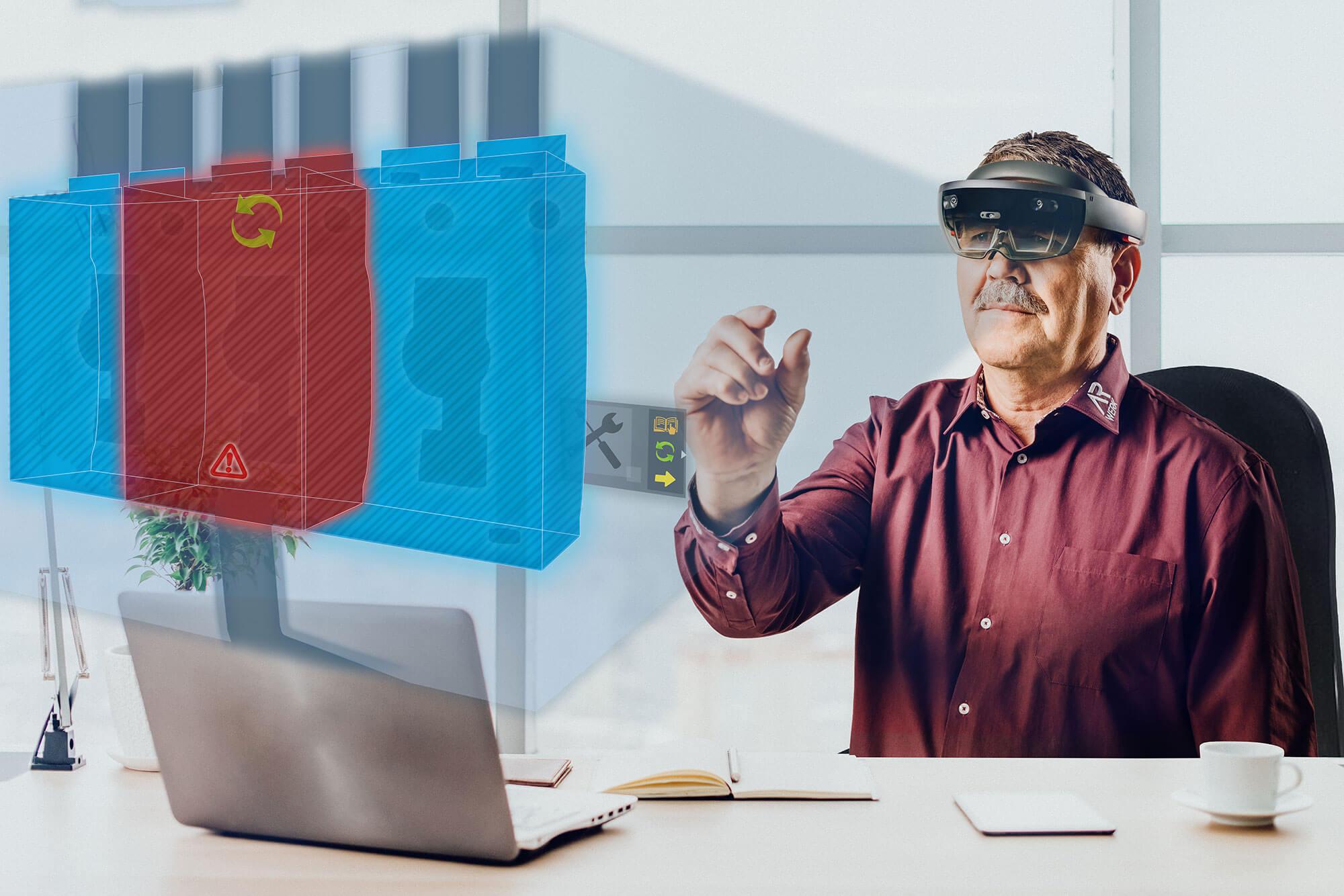 Spezialist unterstützt Installateur mit Hilfe einer Augmented Reality Brille vom Büro aus